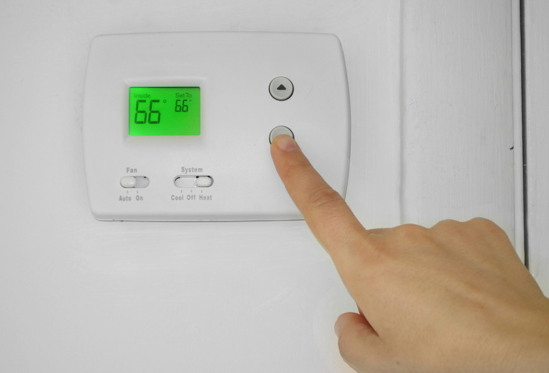 adjusting-thermostat-to-66-degrees