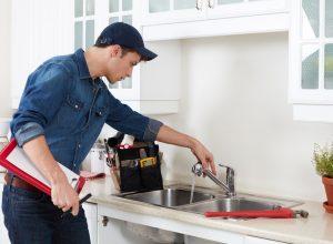 plumber-at-kitchen-sink